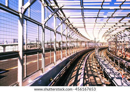 rail track and cityscape of tokyo, view from speed train  - stock photo