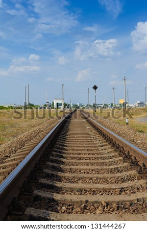 Rail tracks disappearing in the distance, low angle, near focus. Railway details. - stock photo
