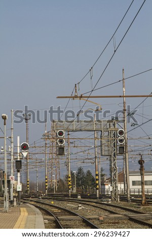 Rail transport - tracks, switches and signal masts on an Italian train station - stock photo