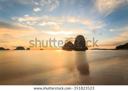 RaiLay Beach and Ko Rang Nok at sunset in Krabi Thailand - stock photo