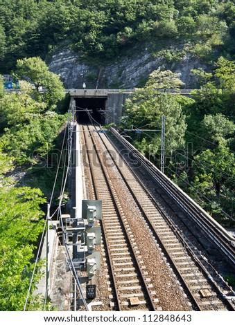 Railroad bridge and tunnel - stock photo