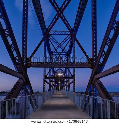 Railroad bridge converted to pedestrian crossing over the Arkansas River in Little Rock, Arkansas - stock photo