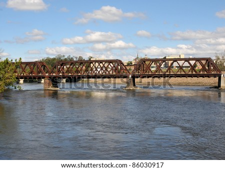 Railroad bridge in Shelton, Connecticut, under a blue sky on a fall day - stock photo