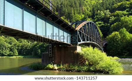 Railroad bridge over water located in Slovakia. - stock photo