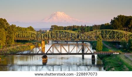 Railroad Car Bridges Puyallup River Mt. Rainier Washington - stock photo