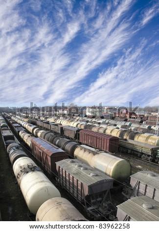 Railroad cars on a railway station. Cargo transportation. Work of industry. Urban scene - stock photo