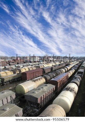Railroad cars on a railway station. Cargo transportation. Work of industry. Urban scene - stock photo
