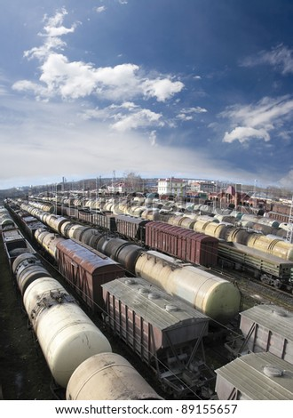 Railroad cars on a railway station. Cargo transportation. Work of industry. Urban scene. Train. Wide angle. Panoramic view - stock photo