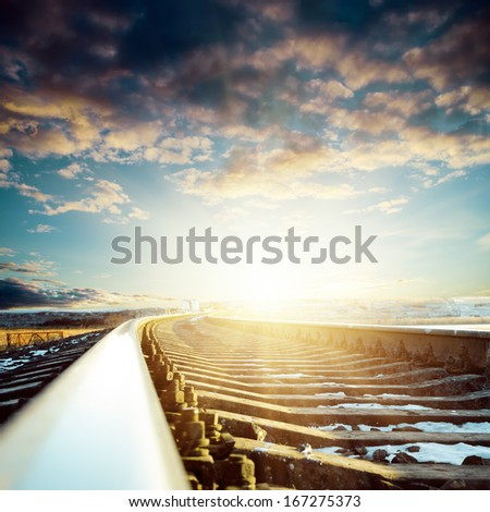 railroad close up to sunset - stock photo