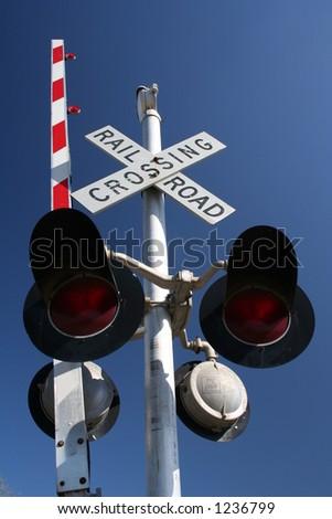 railroad crossing and old drawbridge bridge - stock photo