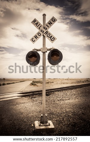 Railroad crossing sign ghost town united states - stock photo