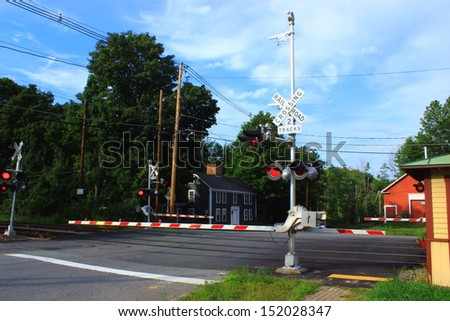Railroad Crossing sign with Lights Flashing - stock photo