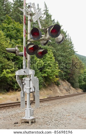 Railroad Crossing Signal in the Pacific Northwest - stock photo