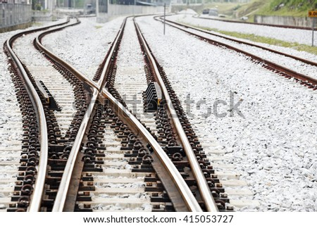 Railroad crossover tracks on a gravel bed.  - stock photo