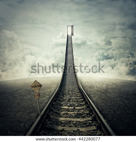 Railroad of opportunity along a cracked desert ground, going up as a staircase to a opened door in the sky, road to heaven symbol. Success plan, business concept  - stock photo