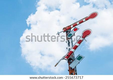 Railroad signal poles on sky - stock photo