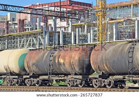 Railroad tank wagon and construction site background - stock photo