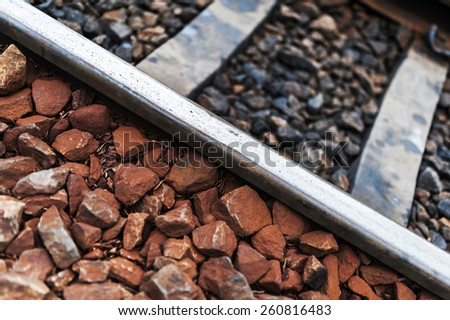 Railroad Track old line with stone - stock photo