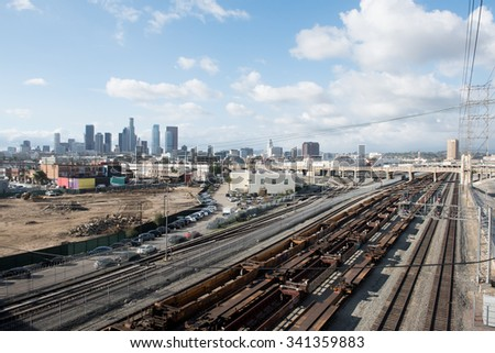 Railroad tracks and river viaduct against Los Angeles city background - stock photo