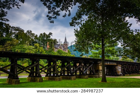 Railroad tracks and view of a church in Harper's Ferry, West Virginia. - stock photo