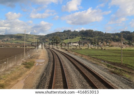 Railroad tracks are built for conveyance of passengers and goods on trains. - stock photo