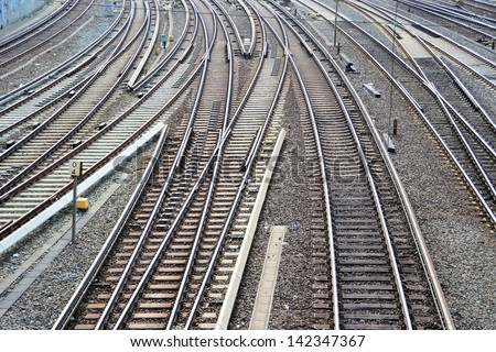 Railroad tracks at a train station - stock photo