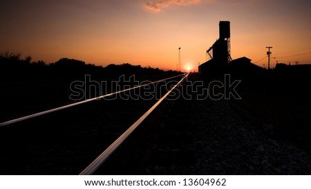 Railroad Tracks at Sunset - stock photo