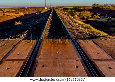 Railroad Tracks Heading North into New Mexico Desert. - stock photo