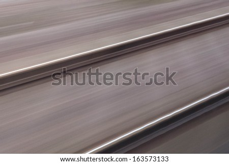 Railroad tracks in fast motion - stock photo