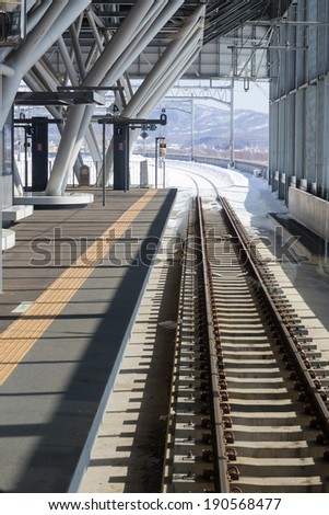 Railroad tracks in the winter, viewed from station - stock photo
