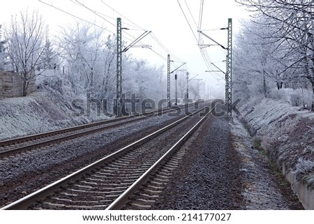 Railroad tracks in winter fog - stock photo
