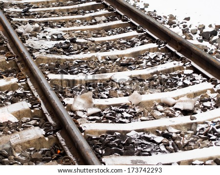 Railroad tracks in winter with snow - stock photo