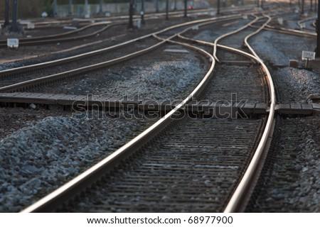 Railroad tracks leading the eye to the horizon. - stock photo