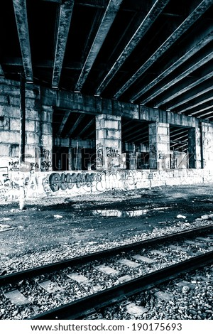 Railroad tracks under a bridge in Philadelphia, Pennsylvania. - stock photo