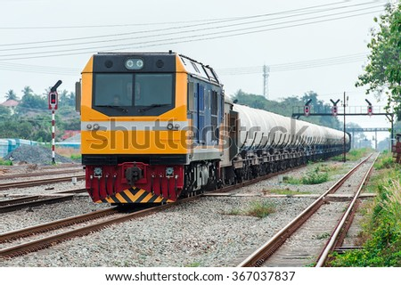 railroad transportation white tank cars with oil - stock photo