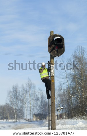 Railroad worker assess the quality of the pole age - stock photo