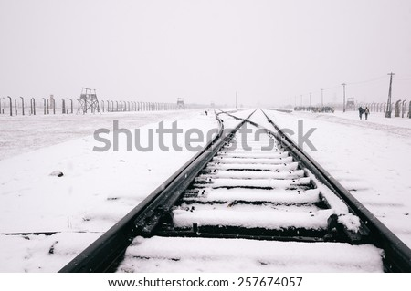 Rails in the snow covered concentration camp of Auschwitz  Birkenau, Poland - stock photo