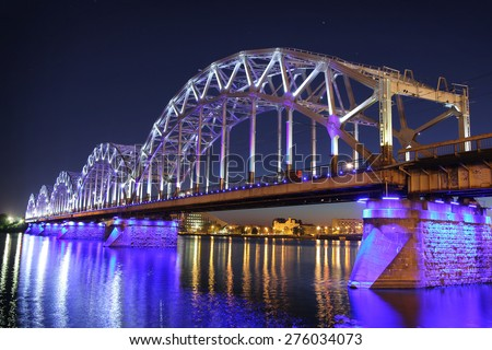 Railway bridge at night in Riga, Latvia - stock photo