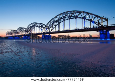 Railway bridge at night in winter close up - stock photo