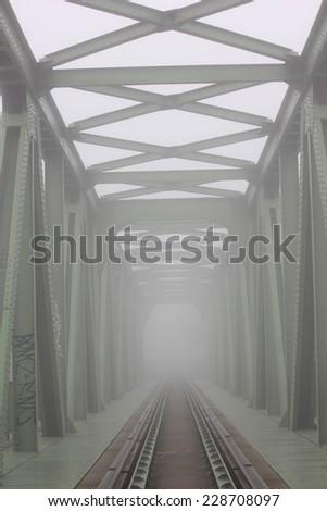 railway bridge, fog - stock photo