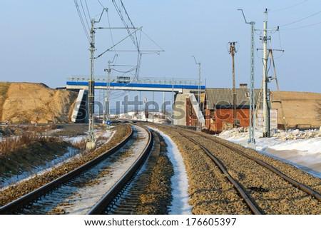 Railway crossing bridge over the railway modernization. - stock photo