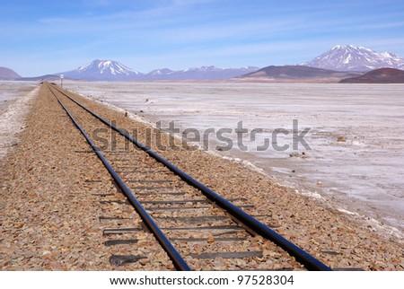 Railway in desert landscape, Bolivia - stock photo
