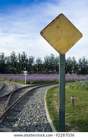 Railway junction with warning sign - stock photo