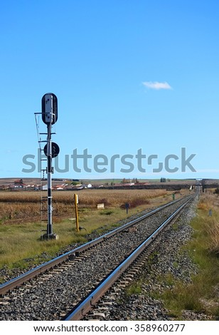 Railway landscape with fire signal - stock photo