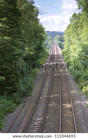Railway lines leading into distance - stock photo