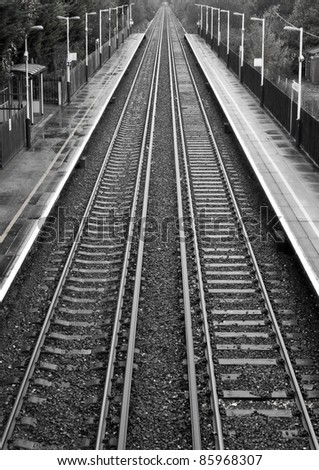 Railway lines travel through a railway station. - stock photo