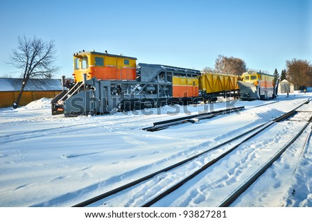 Railway locomotives for snow removal  and repair of the railway against a winter landscape - stock photo