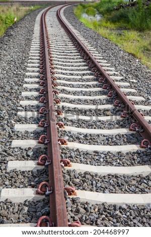 Railway, Railroad, Train Tracks, With Green Pasture - stock photo