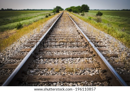 Railway, Railroad, Train Tracks, With Green Pasture Early Morning - stock photo