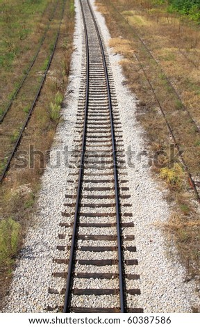 Railway rails leaving in a distance - stock photo